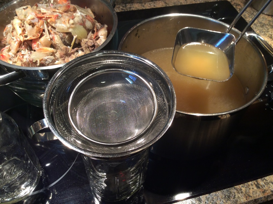 Ladle Hot Broth Through Strainer into Jars