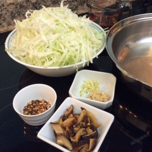 Simple ingredients ready: cabbage, mushroom soaking water, garlic, shrimp, shiitake, red pepper flakes