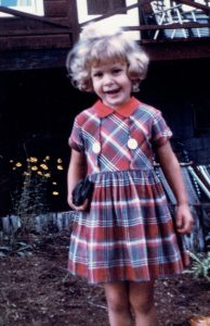 Sally_standing_ in_a_plaid-Dress-red_collar
